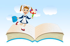 Cheerful girl with a school uniform on an open book Royalty Free Stock Photography