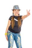 Cheerful girl schoolgirl in a hat Royalty Free Stock Images