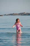 Cheerful girl in a sea water. Cheerful girl playing in a sea water royalty free stock photos