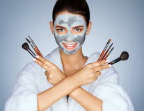 Cheerful girl with set of make up brushes. Royalty Free Stock Photography
