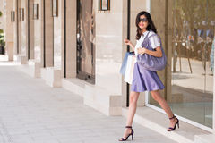 Cheerful girl with shopping bags Stock Photo