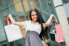 Cheerful Girl With Shopping Bags Stock Photos