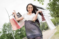 Cheerful Girl With Shopping Bags Royalty Free Stock Photos