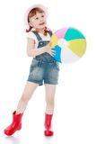 Cheerful girl in short summer shorts and boots Stock Image