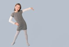 Cheerful girl showing empty place Royalty Free Stock Photography
