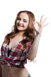 Cheerful girl showing gesture OK Royalty Free Stock Photography