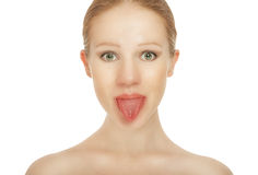 Cheerful girl shows tongue Stock Images