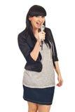Cheerful girl singing Stock Photo