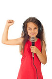 Cheerful girl singing stock images