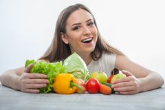 Cheerful girl is sitting with healthy food Royalty Free Stock Photos