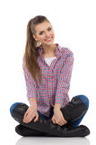 Cheerful Girl Sitting Legs Crossed Royalty Free Stock Photo