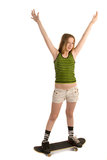 Cheerful girl on the skateboard Royalty Free Stock Image