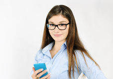 Cheerful girl with smartphone Royalty Free Stock Photo