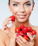 Cheerful girl with strawberries Royalty Free Stock Images