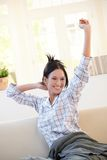 Cheerful girl stretching in morning Royalty Free Stock Image