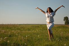 Cheerful girl on the summer field Royalty Free Stock Photo