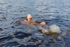 Cheerful girl swimming