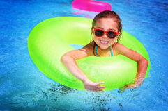 Cheerful girl in swimming pool Stock Photos
