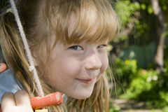 Cheerful girl on a swing Royalty Free Stock Image