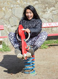 Cheerful girl on the swing Royalty Free Stock Photo