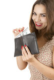 Cheerful girl taking hundred dollars from wallet Royalty Free Stock Photography