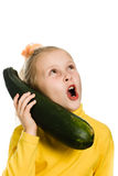 Cheerful girl talking on the zucchini Stock Photo