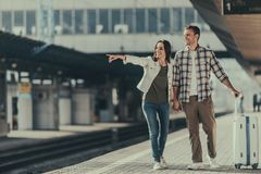 Cheerful girl telling with optimistic man outside stock photos