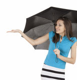 Cheerful girl with umbrella checking for rain Stock Image