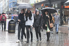 Cheerful girl under umbrellas are on Carnaby Street Stock Images
