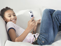 Cheerful Girl Using Cellphone Stock Images