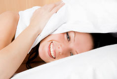 Cheerful girl wakes up stock photography