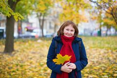 Cheerful girl in warm red scarf enjoying fall day Stock Photos