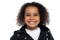 Cheerful girl wearing black leather jacket Stock Photos