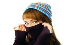 Cheerful girl wearing a warm sweater and a hat Stock Photo