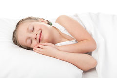 Cheerful girl in white bed Royalty Free Stock Photography