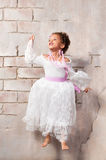 Cheerful girl in a white dress mulatta jump Stock Photography