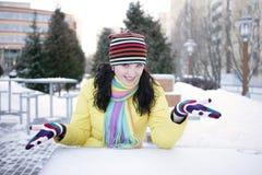 Cheerful girl in winter. Schaslivaya girl zimoyruki sent to the parties Royalty Free Stock Photos