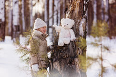 Cheerful girl in the winter snowy forest walks Royalty Free Stock Image