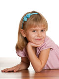 Cheerful girl on the wooden floor Royalty Free Stock Photography