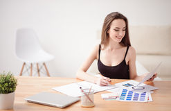 Cheerful girl working at the table Royalty Free Stock Photography