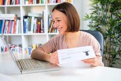 Cheerful girl writing job resume on the computer Royalty Free Stock Photos