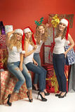 Cheerful girlfriends among huge presents Stock Photography