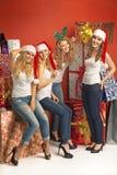 Cheerful girlfriends among huge presents Stock Photography