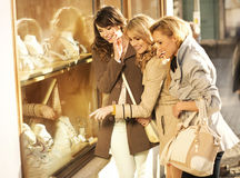Cheerful girlfriends looking at the jewellery Stock Image