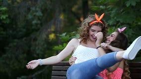 Cheerful girlfriends meet in a park. stock video
