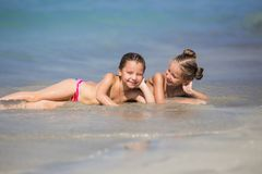 Cheerful girlfriends playing around on vacation. Happy girls on the sea. Cheerful girlfriends playing around on vacation royalty free stock photography
