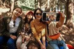 Cheerful girlfriends are taking selfie in nature royalty free stock image