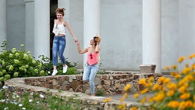 Cheerful girlfriends walking hand in hand. stock video footage