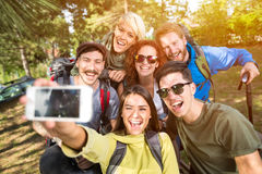 Cheerful girls and boys makes selfie Stock Photo