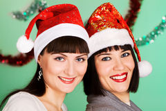 Cheerful girls in christmas hats Royalty Free Stock Photo